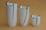 Black and white cut porcelain vessels
