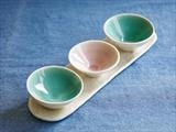 three dipping bowls on tray